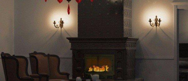 Классический изразцовый черный камин в интерьере гостиной